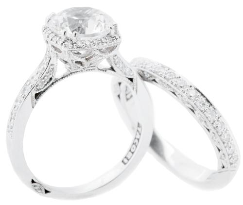 Tacori's 18K white gold ring with 2 ct. diamond and accent diamonds (.37 total cts.) and 18K white gold band with diamonds (.29 total cts.), both from Polly's Fine Jewelry; $28,000 and $2,870,  respectively (Also available through Croghan's Jewel Box and REEDS Jewelers.)