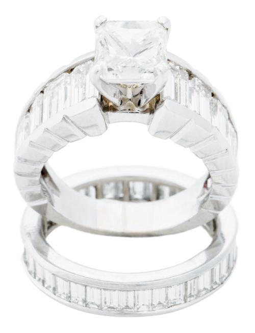 18K white gold ring with 2.01 ct. diamond and accent diamonds (3.9 total cts.) and 18K white gold band with diamonds (1.85 total cts.),  both from Nice Ice  Fine Jewelry; $37,440 and $8,360, respectively