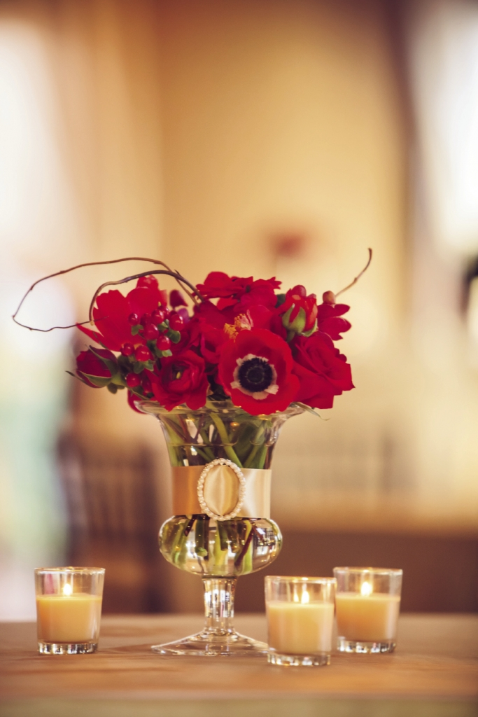 PRETTY AS A POPPY: Judy Johnston, exclusive floral designer for Engaging Events, dotted the reception with vivid red poppies accented with golden ribbon.
