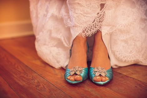 SOMETHING BLUE: The bride slipped into a pair of something blue. Check out how stunning the turquoise looks with the red that infused the big day.
