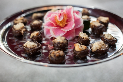 FRESH IDEA: Mosaic Catering dressed trays of stuffed mushrooms with fresh camellias that were picked from the grounds.