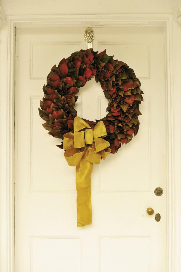 'TIS THE SEASON: The green and rust of wreaths from The Magnolia Company were accented with golden bows for continuity.