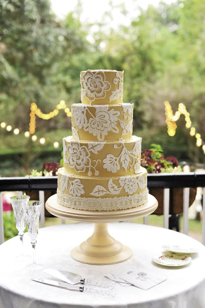 PATTERN PARADE: Jim Smeal's gold-and-white masterpiece borrowed patterns from the linens, Allison's sash, and the home's staircase. Vintage china from Charleston Starfish was a colorful surprise from the bride's mother.