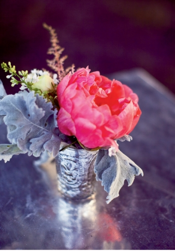 TINY TOUCHES: Playing with the downhome theme and a palette of pinks and corals, Whitney placed small heirloom-style vases of colorful peonies throughout the reception.