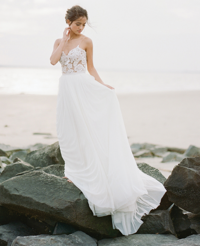"Beach Brides: ""Dahlia"" midi dress with tulle skirt overlay from Emily Kotarski Bridal Studio and Showroom. Why It Works: ""Switch up the formal look of 'Dahlia' by adding a flowing tulle skirt and you exude major beach wedding vibes."" —Emily Kotarski"