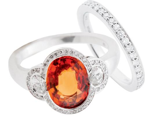 Hans D. Krieger's 18K white gold spessartite garnet and diamond ring ($5,825) and 18K white gold and diamond band (price on  request), both from Paulo Geiss Jewelers