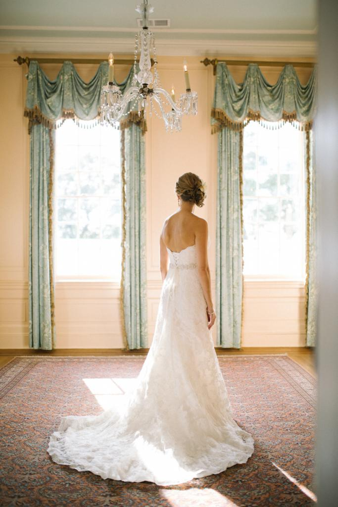 Bride's gown by Maggie Sottero (available locally at Bridals by Jodi). Hair by Paper Dolls. Image by Clay Austin Photography.