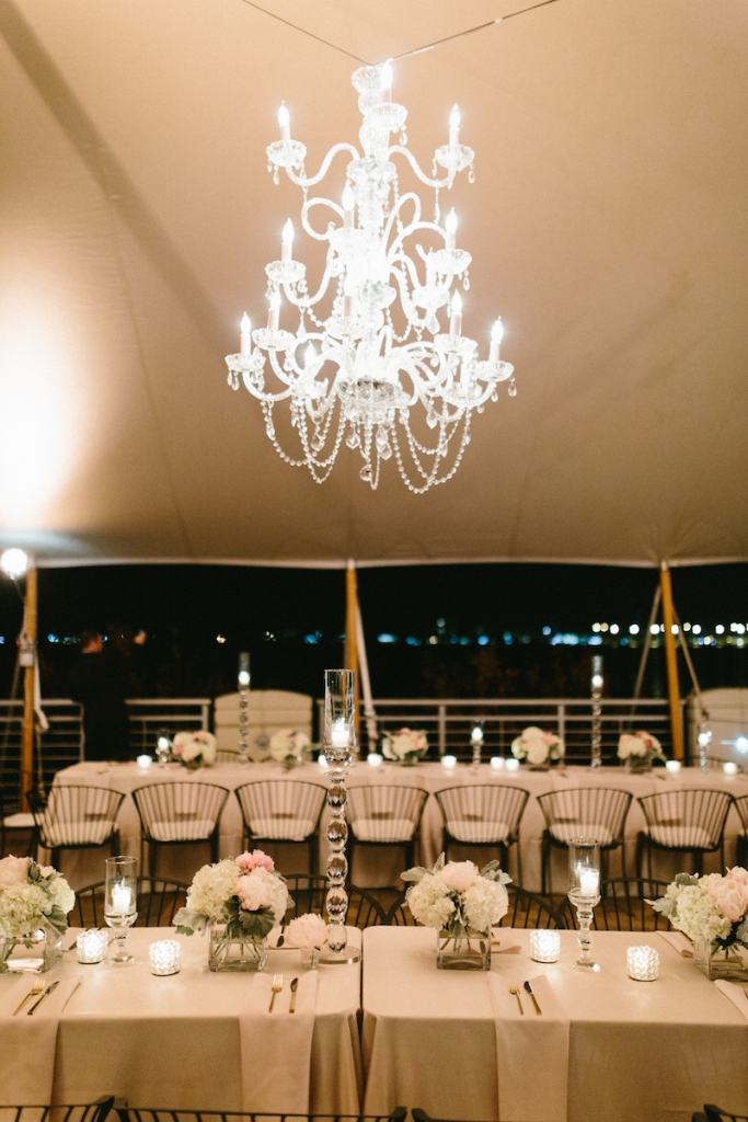 Wedding design by Fini Event Planning and Inventive Environments. Tent by Sperry Tents Southeast. Rentals from Snyder Events, EventWorks, and EventHaus. Lighting by Innovative Event Services. Image by Clay Austin Photography at Harborside East.