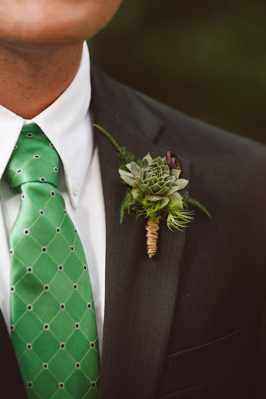 Groom's attire by Jos A. Bank. Boutonniere by Heidi Inabinet of On a Limb. Image by Amelia + Dan Photography.