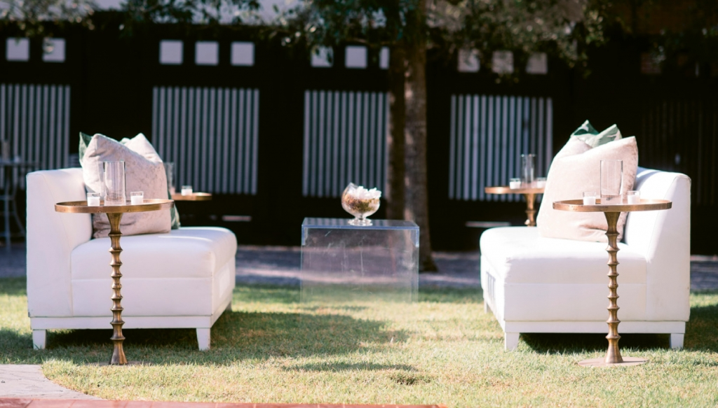 Sleek lounges with Lucite and gold tables mimicked the understated glamour of the décor inside the museum and provided comfy conversation areas for guests during the outdoor reception.  <i>Image Timwill Photography</i>