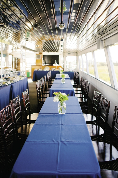 GALLEY KITCHEN: Open seating and food stations, like those Hamby Catering set up for Jamie and Tyler, work well for cruise receptions, as guests can munch, mingle, and sightsee as they wish, says Camille. Keep décor simple, she adds, so the scenery takes center stage.