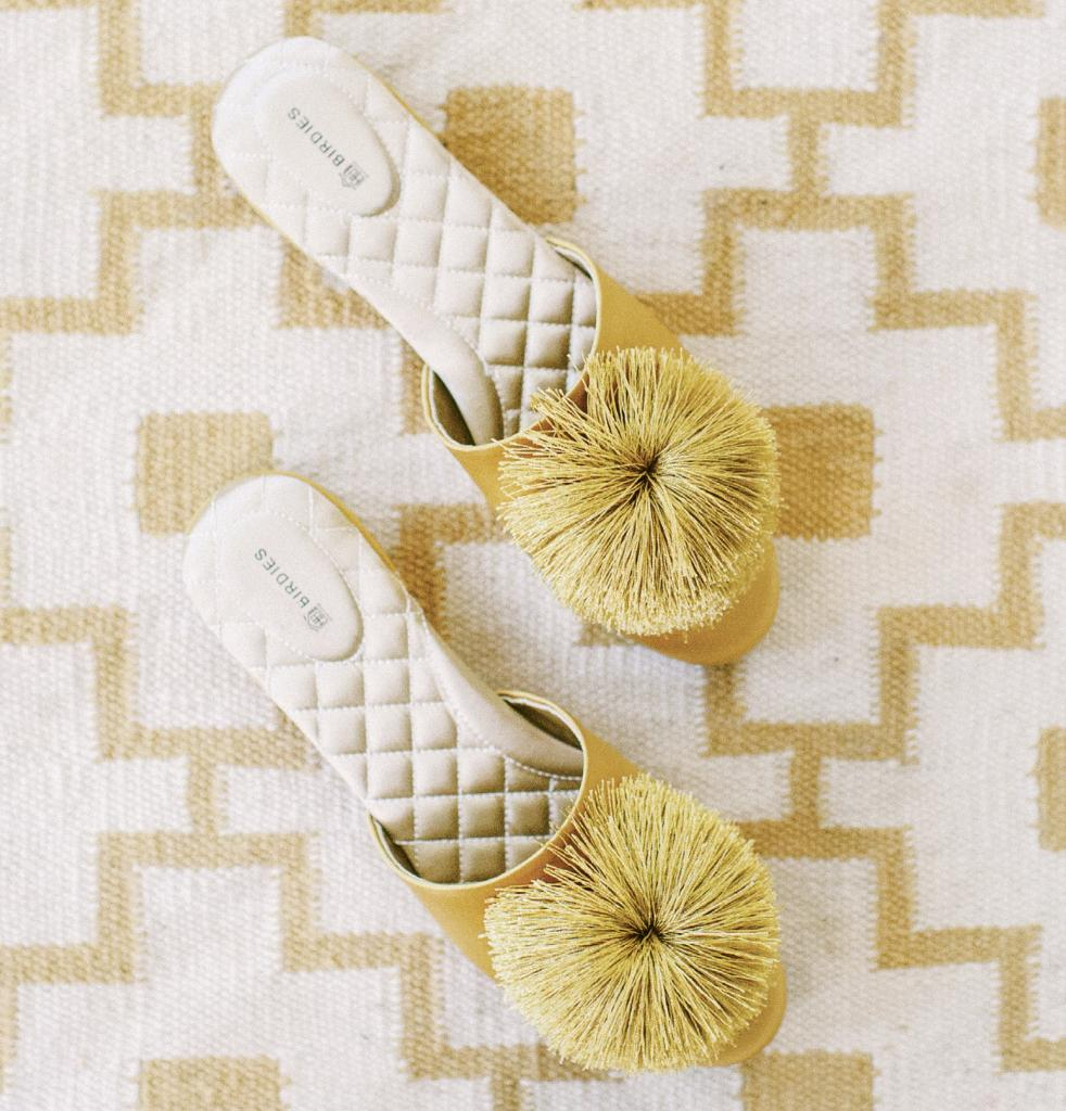 "Can you build a bridal luncheon around a pair of slippers? Sure you can! This pair of pretty slides inspired a gathering based on ""The Golden Girls"" (yep, that show). Style bloggers Andrea Serrano and Liz Martin think a themed post-wedding party is the way to go."
