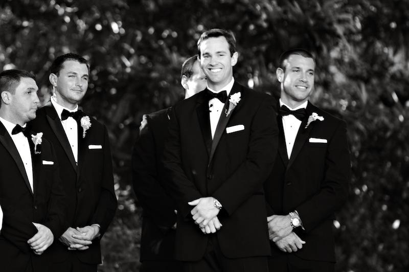 Groom and groomsmen's attire by Jos. A. Bank. Boutonnieres by HB Stems. Image by Kelli Boyd Photography.