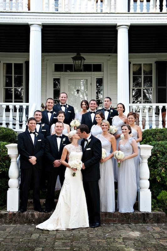 Bridal gown by Lela Rose. Bridesmaids' attire by Amsale from Bella Bridesmaids. Groom and groomsmen's attire by Jos. A. Bank. Florals by HB Stems. Image by Kelli Boyd Photography.