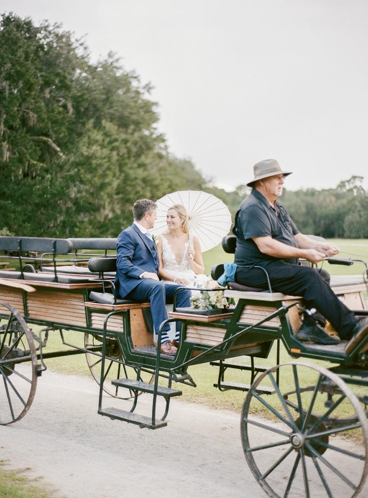 "The couple explored the grounds by wagon after the ceremony; given the bride baked nearly 100 loaves of banana bread (from her mother's ""cherished"" recipe) for welcome bags, she'd earned a little downtime."