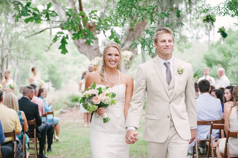 Florals by First Bloom of Charleston. Bride's gown by WTOO through Bridals by Jodi. Groom's attire by Men's Wearhouse. Image by Britt Croft Photography.