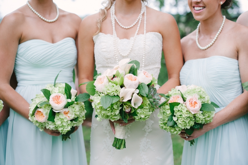 Bouquets by First Bloom of Charleston. Bridesmaid attire through Bella Bridesmaids. Bride's gown by WTOO through Bridals by Jodi. Image by Britt Croft Photography.