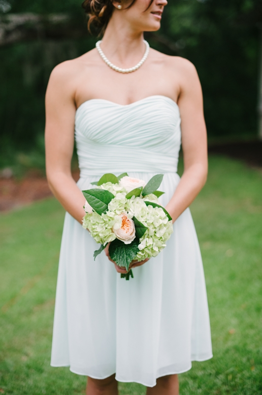 Bouquet by First Bloom of Charleston. Bridesmaid attire through Bella Bridesmaids. Image by Britt Croft Photography.