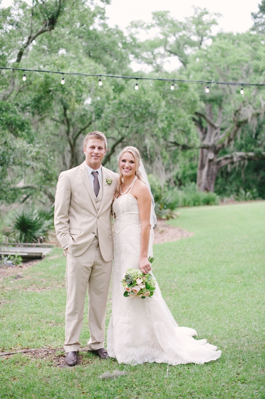 Bride's gown by WTOO through Bridals by Jodi. Groom's attire by Men's Wearhouse. Image by Britt Croft Photography.