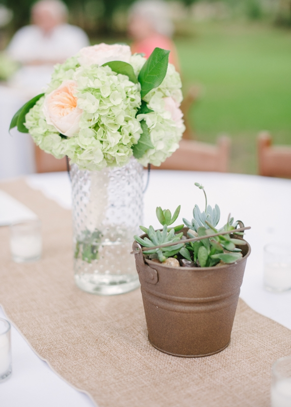 Flowers by First Bloom of Charleston. Wedding design by Ashley Russell of Ashley Nicole Events. Rentals by EventWorks. Image by Britt Croft Photography.