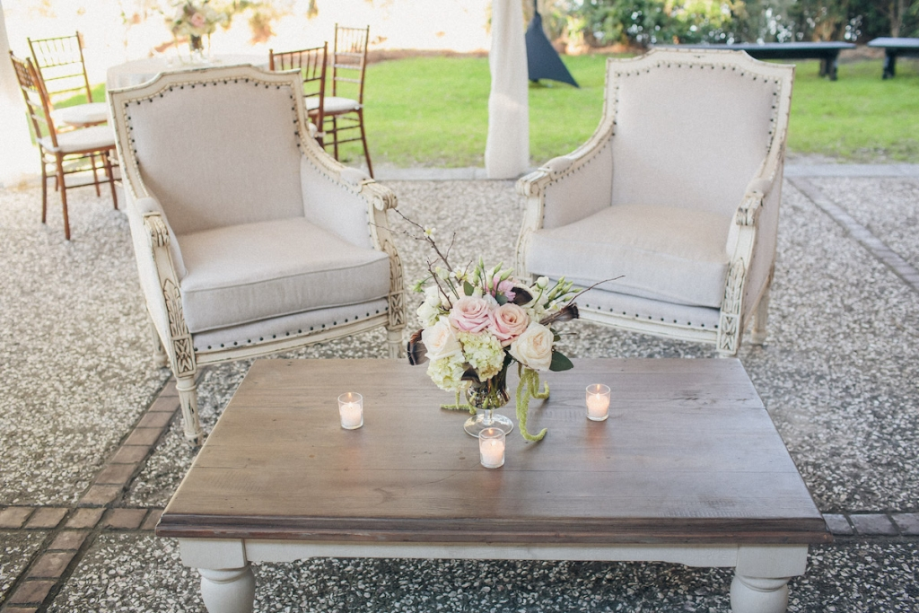 Reception florals by Engaging Events. Rentals by Snyder Events and EventWorks. Image by Richard Bell Weddings at Magnolia Plantation & Gardens.