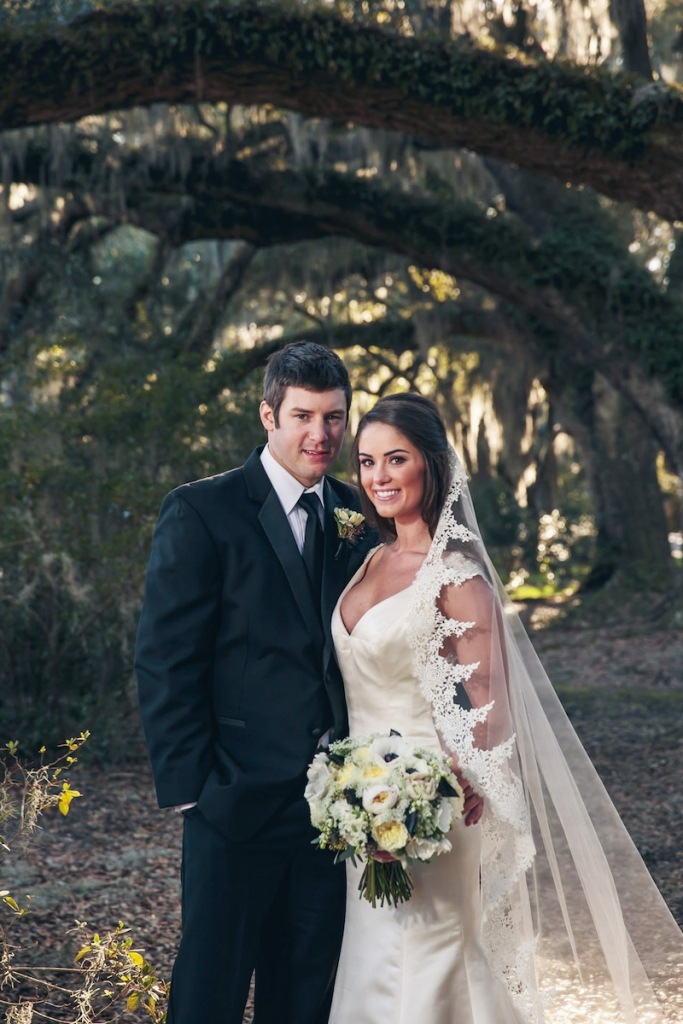 Bride's gown from Bridal House of Charleston. Menswear from David's Tuxedos. Image by Richard Bell Weddings at Magnolia Plantation & Gardens.