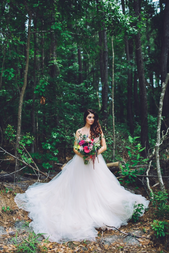Bridal attire by Lazaro from Gown Boutique of Charleston. Bouquet by Anna Bella Florals. Image by Monika Gauthier Photography & Design at The Stables at Boals Farm.