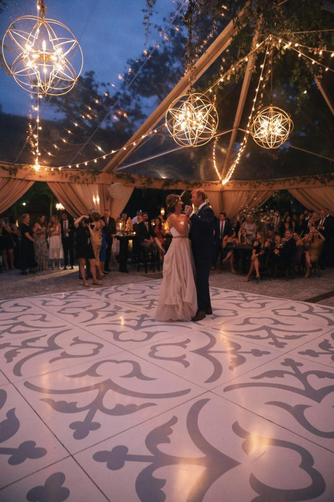 The newlyweds (and later the guests) spun each other on a dance floor patterned with appliqués from Charleston Wraps.