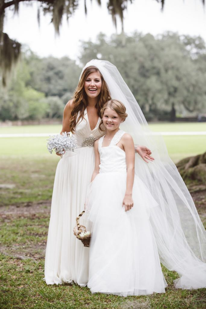 Bride's gown by Jenny Packham from White on Daniel Island. Flower girl's dress from Etsy. Beauty by Wedding Hair by Charlotte. Image by amelia + dan photography at Middleton Place.