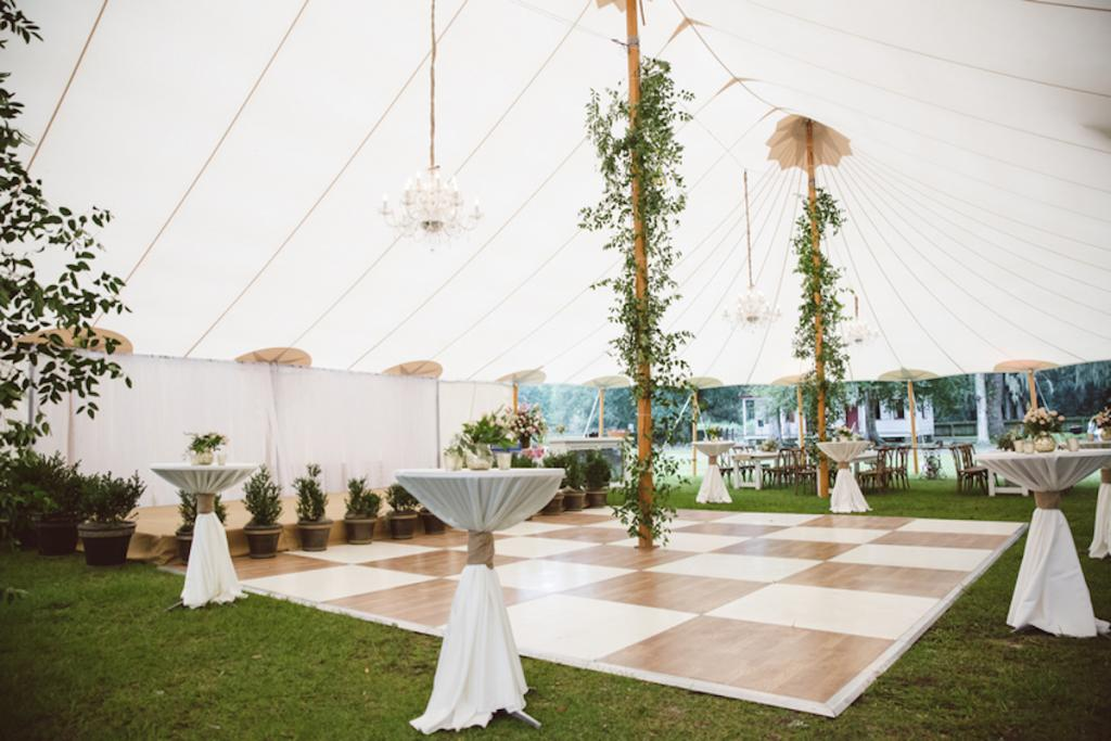 Tent and dance floor from Sperry Tents Southeast. Greens by Nancy's Exotic Plants. Wedding design by Fox Events. Lighting by Innovative Event Services. Image by amelia + dan photography.