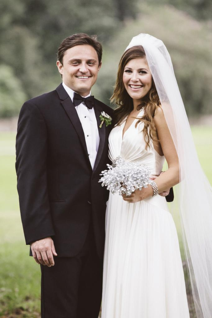 Bride's gown by Jenny Packham from White on Daniel Island. Bouquet from Bridal Bouquets by Ky (Etsy). Beauty by Wedding Hair by Charlotte. Menswear from Charleston Tuxedo. Boutonnière by Fox Events. Image by amelia + dan photography at Middleton Place.