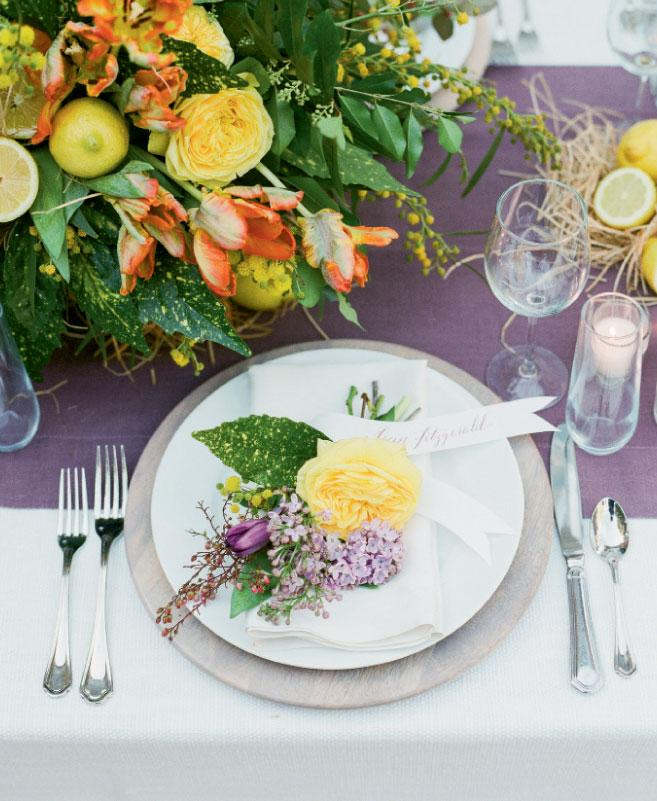 Make a mini masterpiece when you pair calligraphed paper banners with nosegays for placecards and guest favors both. Florals and styling by Mindy Rice Floral & Event Design. Tabletop rentals from Ooh! Events. Photograph by Corbin Gurkin.