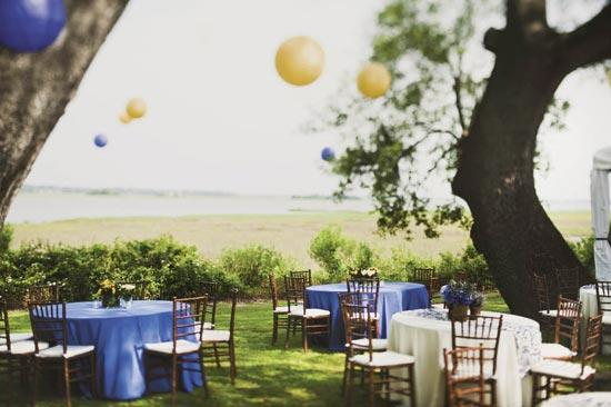 SMART CHOICE: With its sweeping trees and serene view of the marsh, the plantation's surroundings drove the light-touch approach to décor. Here, Stacey placed understated centerpieces atop small reception tables and hung Chinese lanterns overhead.