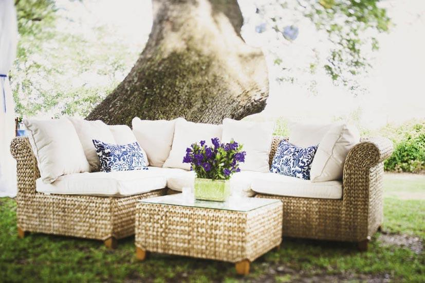SIT BACK: Comfy wicker furniture and custom-made throw pillows gave the outdoor lounge areas a homey feel.