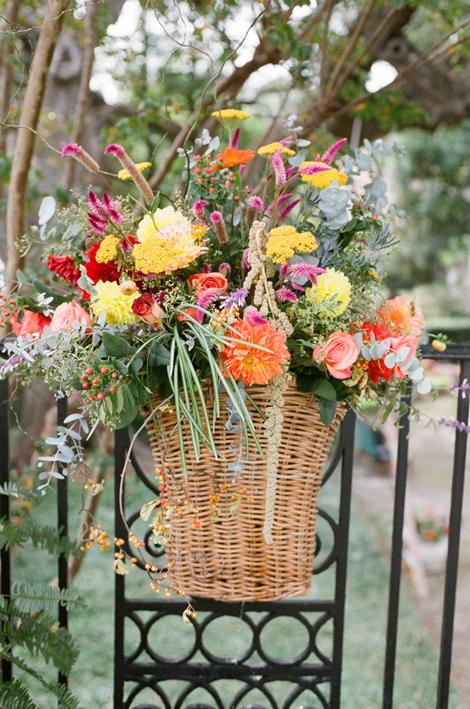 "AUTUMN'S BOUNTY: A friend of the bride's family, Sue Jordan, created earthy arrangements full of autumn-hued buds. ""I wanted the flowers to look like they came straight from the garden,"" says Allison."