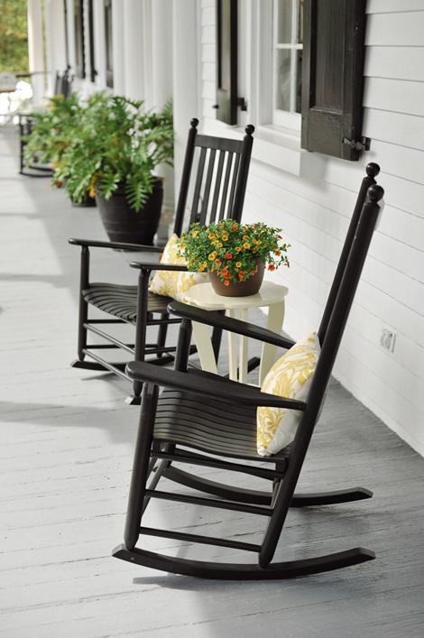 HAVE A SEAT: Rocking chairs—accented with throw pillows in the marigold-and-white fabric that inspired much of the evening's décor—providing comfy seating for guests during the reception.