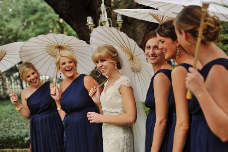 LOVELY LADIES: Parasols carried by the bride and her maids added old-school charm to the wedding party's photo ops..