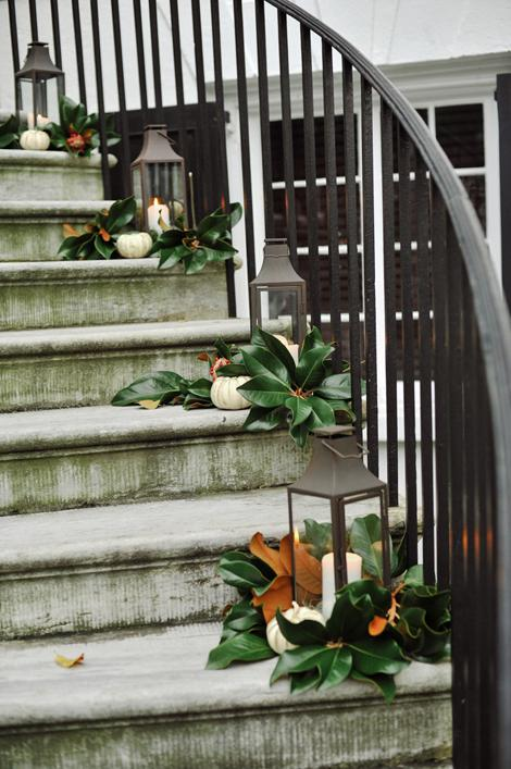 RIGHT THIS WAY: Reflecting the evening's palette, fresh magnolia blooms, cream-colored pumpkins, and pewter lanterns lined the spiral staircase leading to the reception venue's spacious piazza.