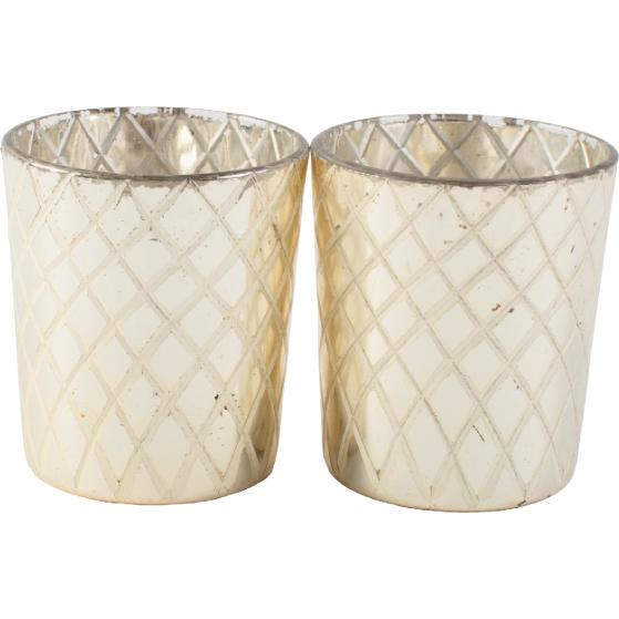 3. LIGHTEN UP WITH VOTIVES: To add sparkle while pulling in cool, Celtic silver, mercury glass votives will sit in clusters on various surfaces. (Votives: One Kings Lane)