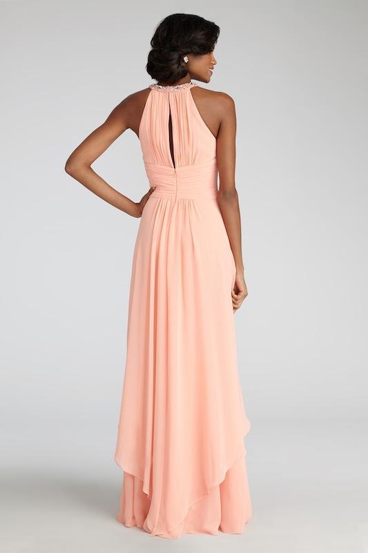 "Donna Morgan's ""Siena"" in Peach Fuzz. Available in Charleston through Bella Bridesmaids."