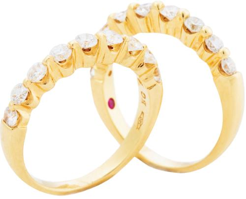 Two 18K yellow gold bands with diamonds (.60 total cts. each) from Roberto Coin; $2,740 each